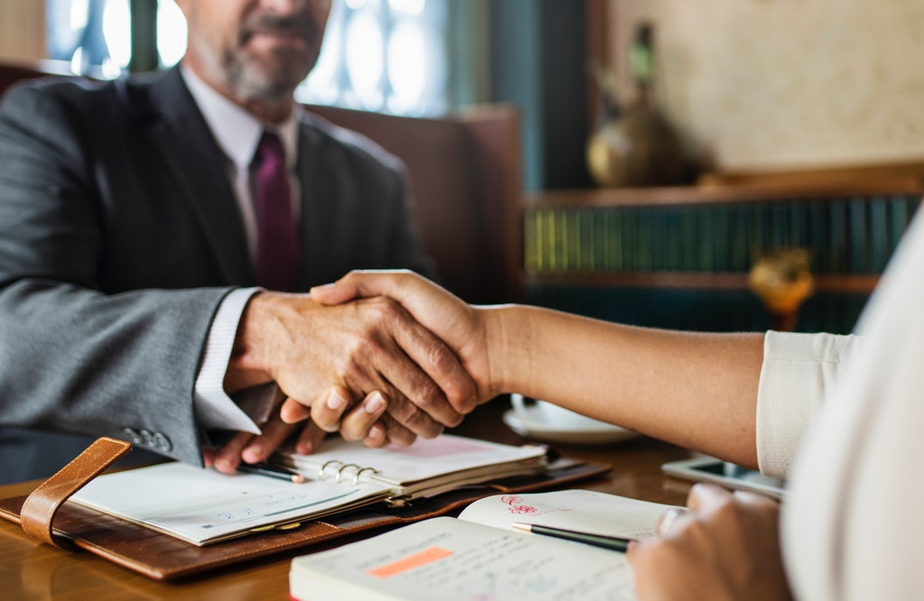 attorney client shaking hands bankruptcy