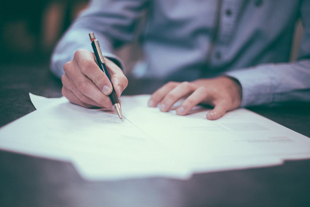 man filling out paperwork bankruptcy