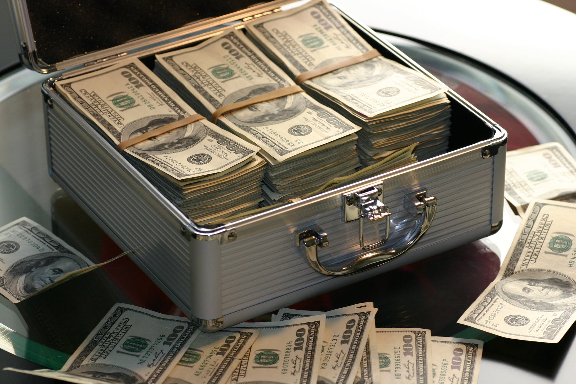 briefcase loaded with dollar bills